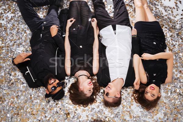 Neşeli güzel insanlar rahatlatıcı konfeti Stok fotoğraf © deandrobot