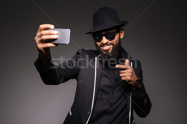 Man in trendy cloth taking selfie photo Stock photo © deandrobot