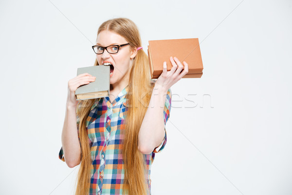 Female student biting book Stock photo © deandrobot