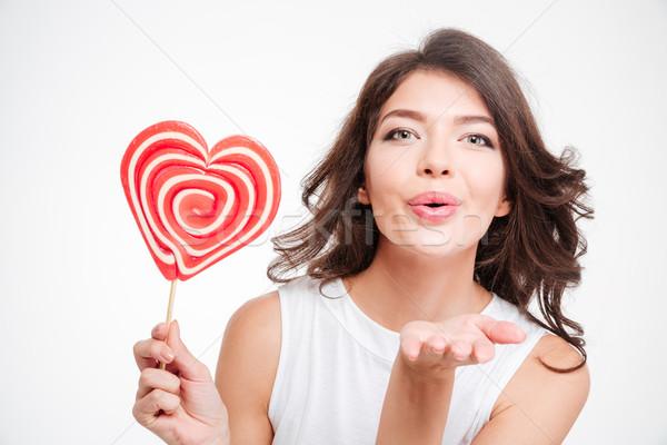 Mulher pirulito beijo câmera Foto stock © deandrobot
