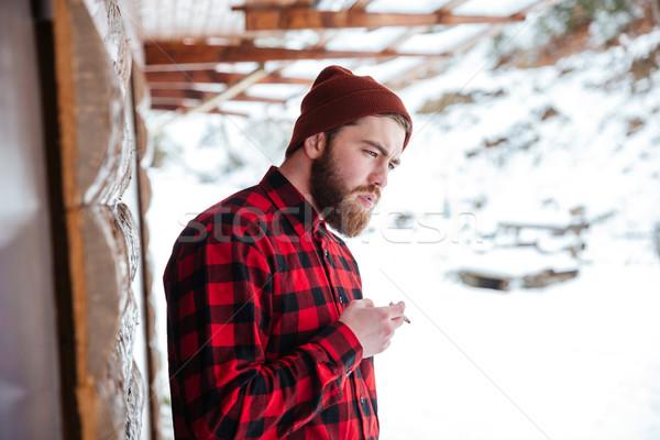 Man smoking cigarette outdoors Stock photo © deandrobot