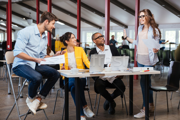 Smiling people on business meeting in office Stock photo © deandrobot