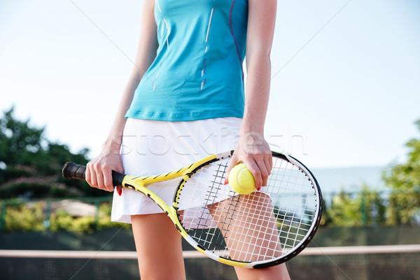 Közelkép portré női lábak teniszütő labda Stock fotó © deandrobot