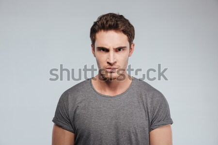 Close up of angry irritated young man looking camera Stock photo © deandrobot