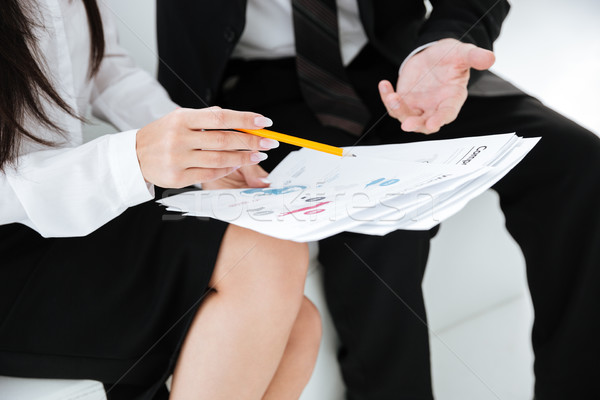 Cropped image of business people with documents Stock photo © deandrobot