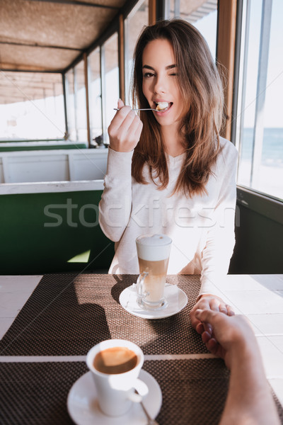 Vertical image of pretty woman on date with coffee Stock photo © deandrobot