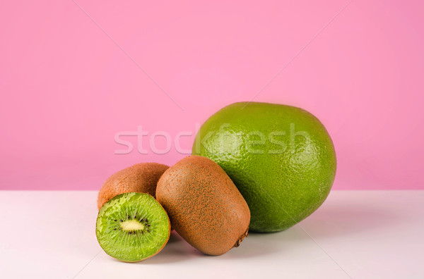 Green pomelo fruit and kiwi on a table Stock photo © deandrobot