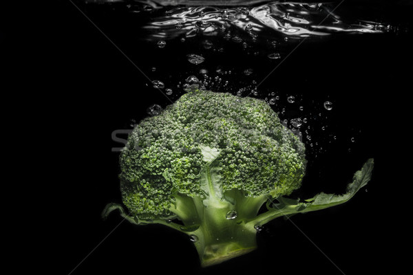 Fresco brócolis água isolado preto natureza Foto stock © deandrobot