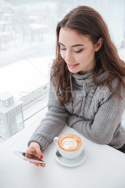 Atractivo potable café teléfono Foto stock © deandrobot