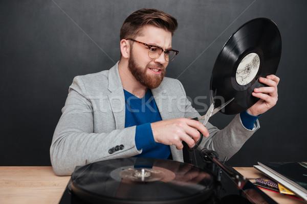 怒っ 若い男 眼鏡 ビニール レコード ストックフォト © deandrobot