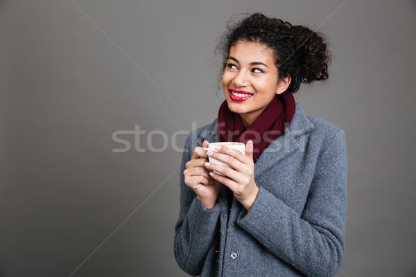 улыбаясь африканских пальто Постоянный питьевой Сток-фото © deandrobot
