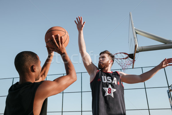 Portrait of a two young sports men playing basketball Stock photo © deandrobot
