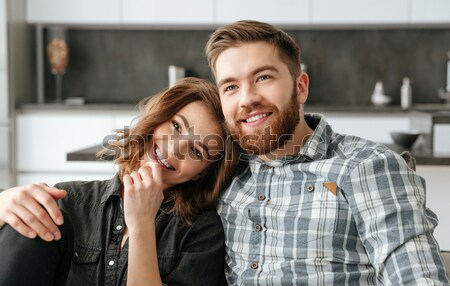 Loving couple sitting on sofa and sleeping indoors Stock photo © deandrobot