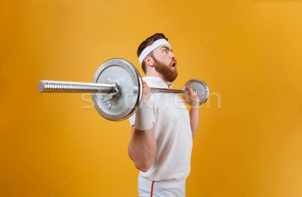 Koncentrált fiatal sportoló gyártmány sport súlyzó Stock fotó © deandrobot