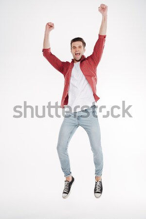 Vertical image of happy man Stock photo © deandrobot