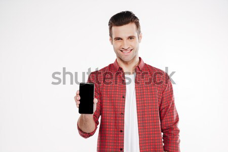 Man showing blank smartphone screen Stock photo © deandrobot
