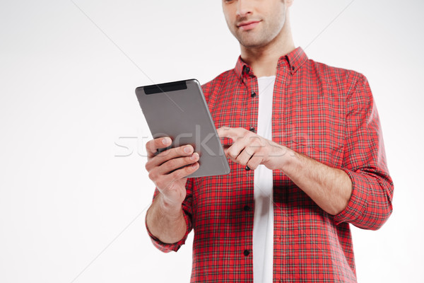 Cropped image of man using tablet computer Stock photo © deandrobot