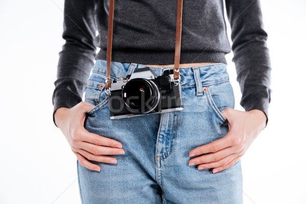 Woman in jeans with retro camera holding hands in pockets Stock photo © deandrobot