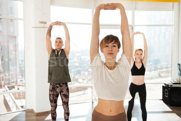Trzy osoby zaręczony jogi sali okno dziewczyna Zdjęcia stock © deandrobot