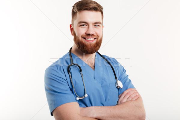 портрет улыбаясь молодым человеком врач стетоскоп Постоянный Сток-фото © deandrobot