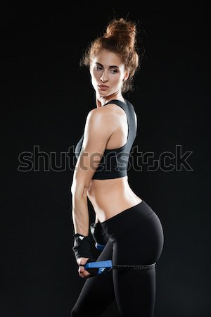 Vertical image of Young Female fighter with expander Stock photo © deandrobot