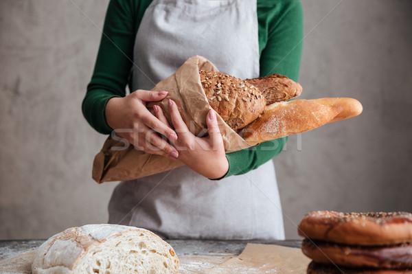 Kép női pék tart táska kenyér Stock fotó © deandrobot