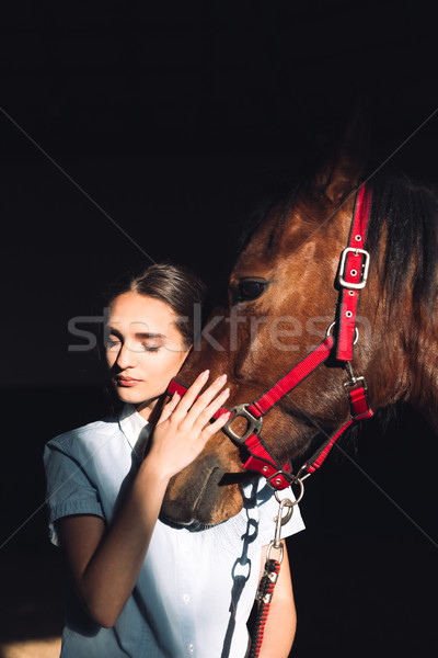 Happy young girl sitting outdoors hugging her horse Stock photo © deandrobot