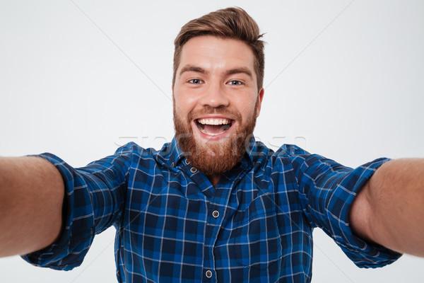 Közelkép kép boldog szakállas férfi kockás Stock fotó © deandrobot