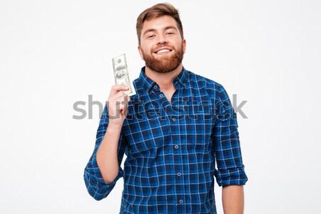 Feliz barbudo homem dinheiro mão Foto stock © deandrobot