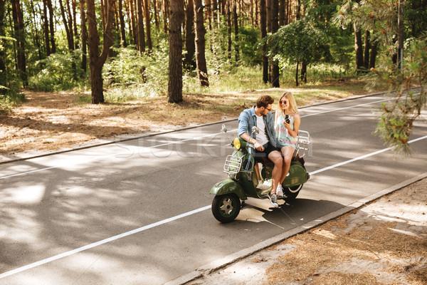 Fiatal jóképű férfi moped barátnő tart kamera Stock fotó © deandrobot