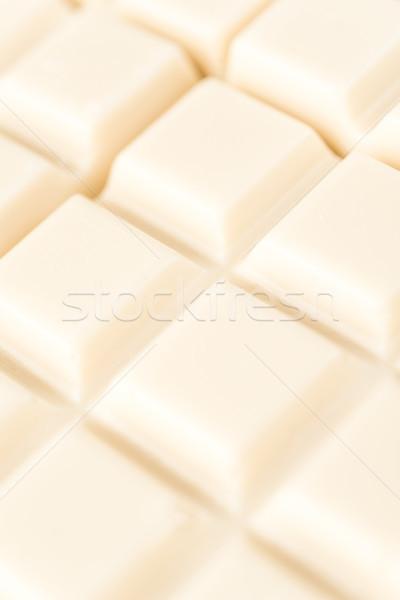 Közelkép fehér csokoládé csempék csokoládé szelet textúra Stock fotó © deandrobot