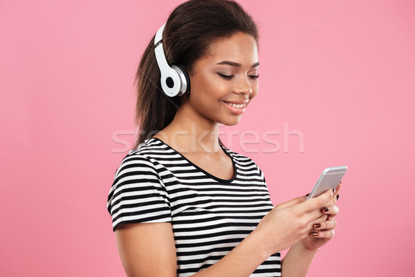 Portrait of a relaxed afro american woman in headphones Stock photo © deandrobot