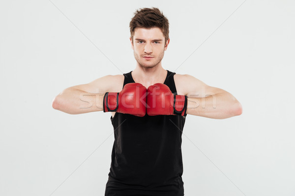 Concentrated young sportsman boxer Stock photo © deandrobot