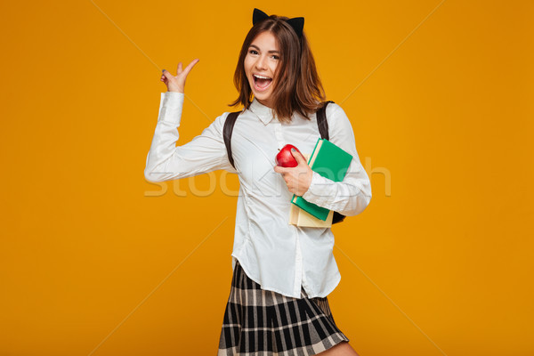 Stock photo: Portrait of a happy schoolgirl holding books