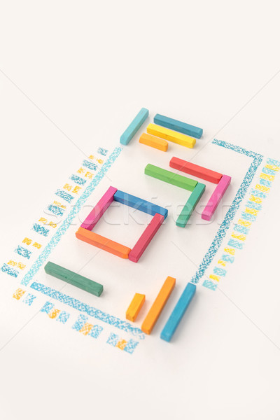 Photo of a cute geometric pattern made of colorful kid's pastel  Stock photo © deandrobot