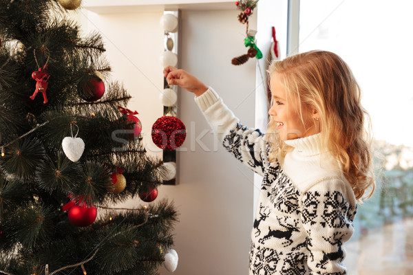 Close-up photo of smiling little blonde girl in knitted sweater  Stock photo © deandrobot