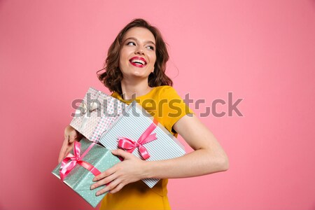 Top view of amazed beautiful woman with opened mouth holding two Stock photo © deandrobot