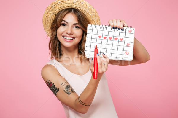 Portrait of a smiling pretty girl in summer hat Stock photo © deandrobot