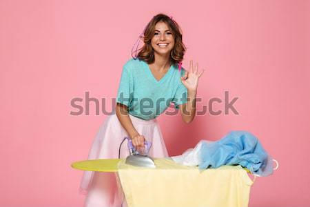 Portret gelukkig jong meisje strijken kleding geïsoleerd Stockfoto © deandrobot