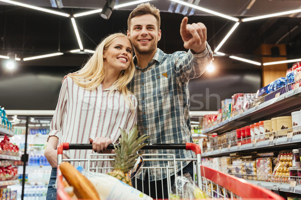 Stock photo: Happy smiling couple with a trolley shopping