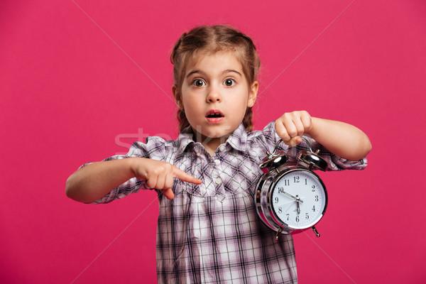 Küçük kız çocuk saat Alarm Stok fotoğraf © deandrobot
