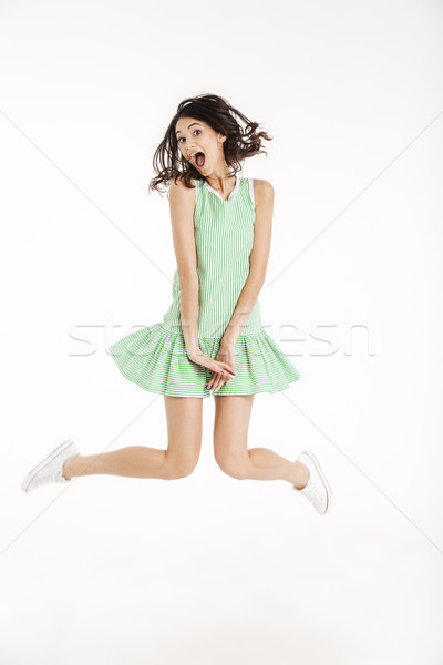 Full length portrait of a funny girl dressed in dress Stock photo © deandrobot