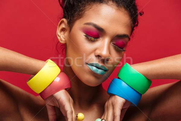 Closeup image of young mulatto woman being bright and stylish ge Stock photo © deandrobot