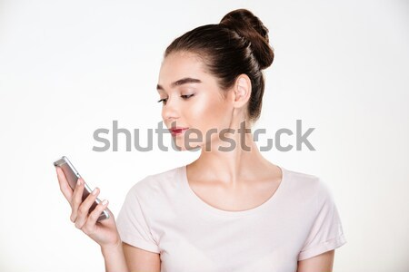 Picture of female with brown hair in bun chatting or reading ebo Stock photo © deandrobot