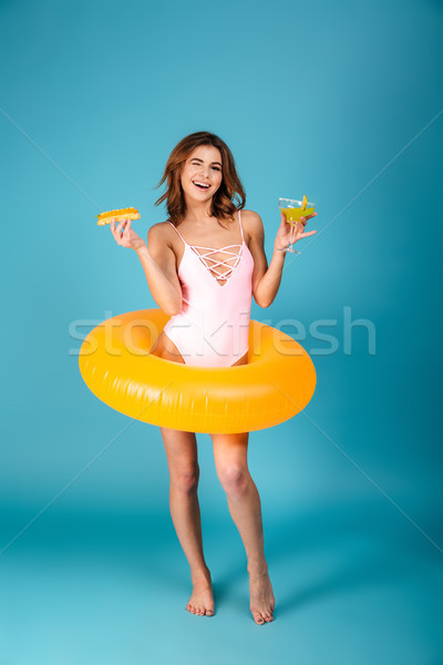 Full length portrait of a happy girl dressed in swimsuit Stock photo © deandrobot