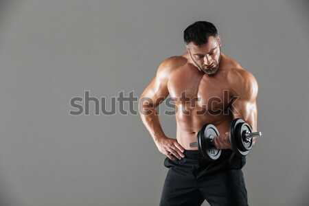 Portrait of a strong shirtless male bodybuilder Stock photo © deandrobot