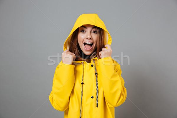 Portré örömteli lány esőkabát pózol fej Stock fotó © deandrobot