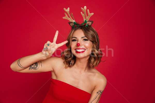Portret glimlachend aantrekkelijk meisje christmas herten Stockfoto © deandrobot