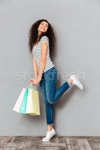 Studio shot of smiling woman feeling pleasure and joy after buyi Stock photo © deandrobot