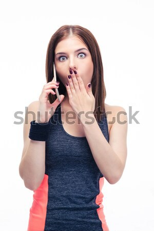 Close-up portrait of scared young asian woman standing with fing Stock photo © deandrobot